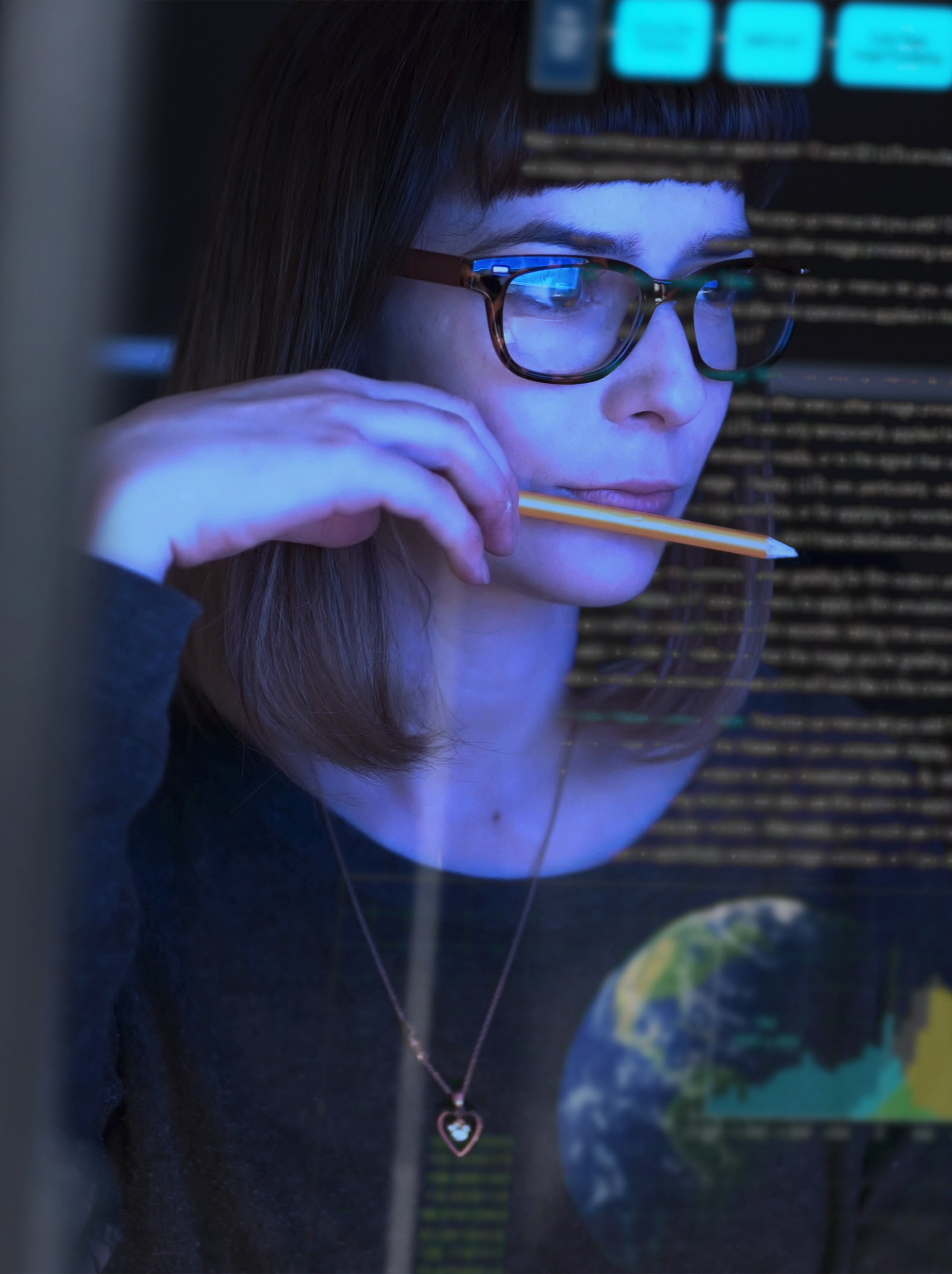 woman studying a see through computer screen