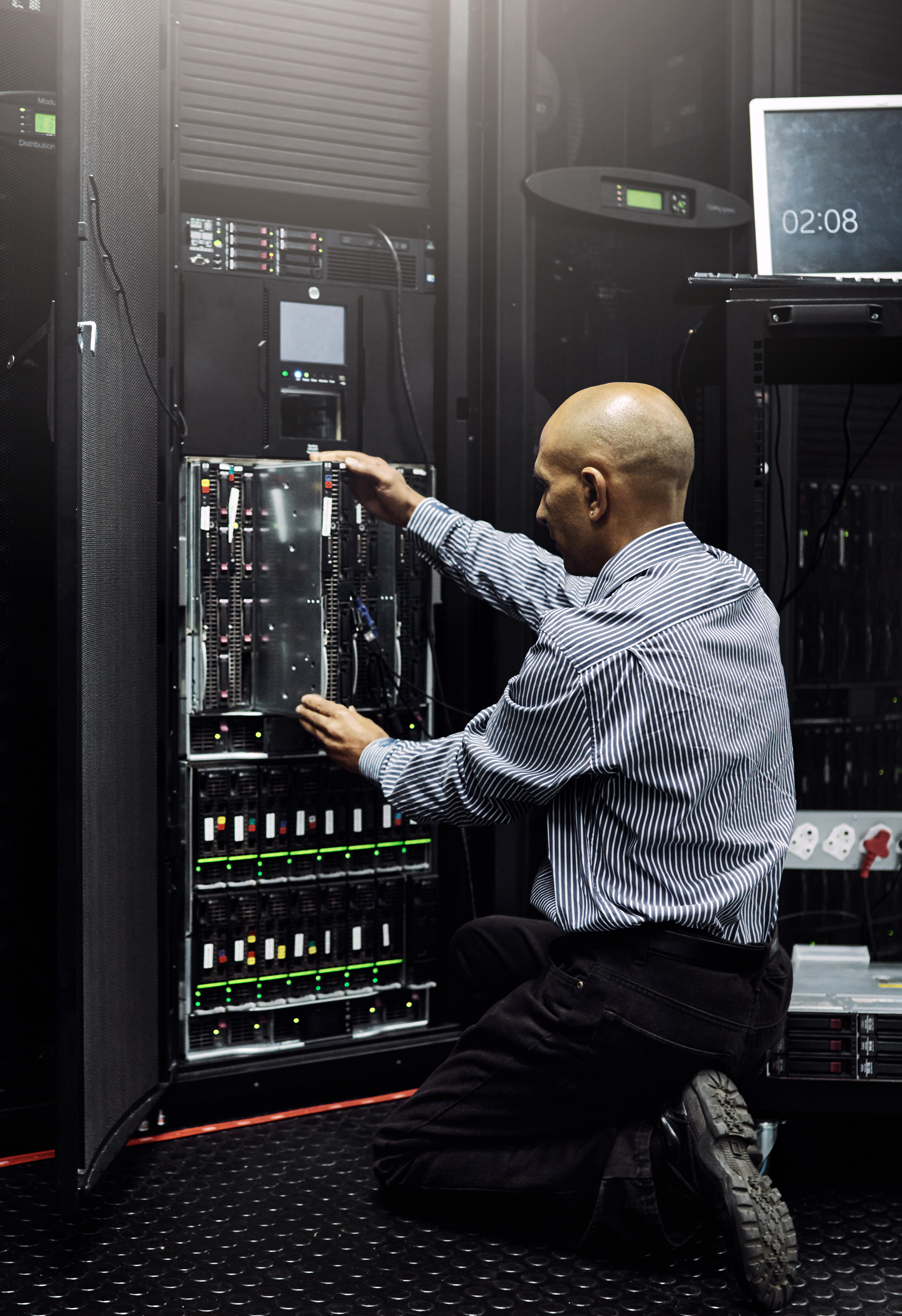 IT technician repairing a computer