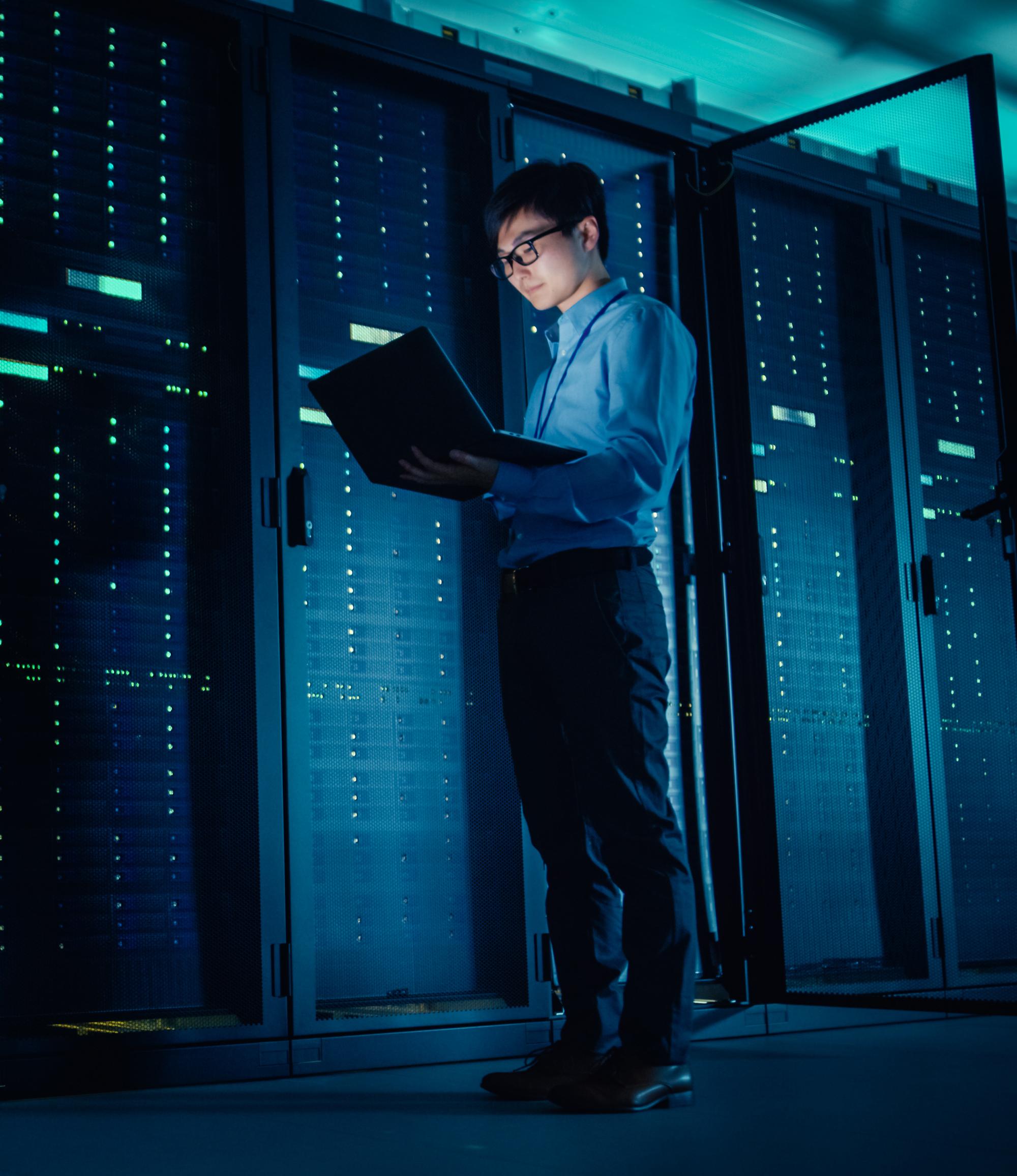 Male IT Technician Running Maintenance Programme on a Laptop