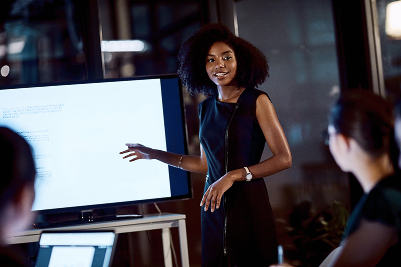 young businesswoman delivering a presentation during a meeting