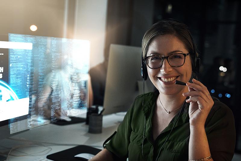 Women wearing a headset in a tech office