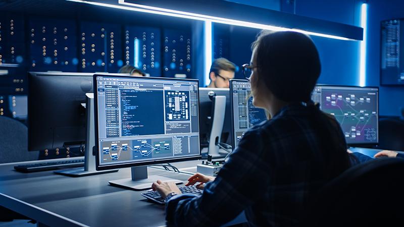 Female IT Programer Working on Desktop Computer in Data Center System Control Room