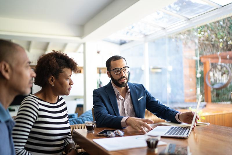 Couple talking to finance advisor
