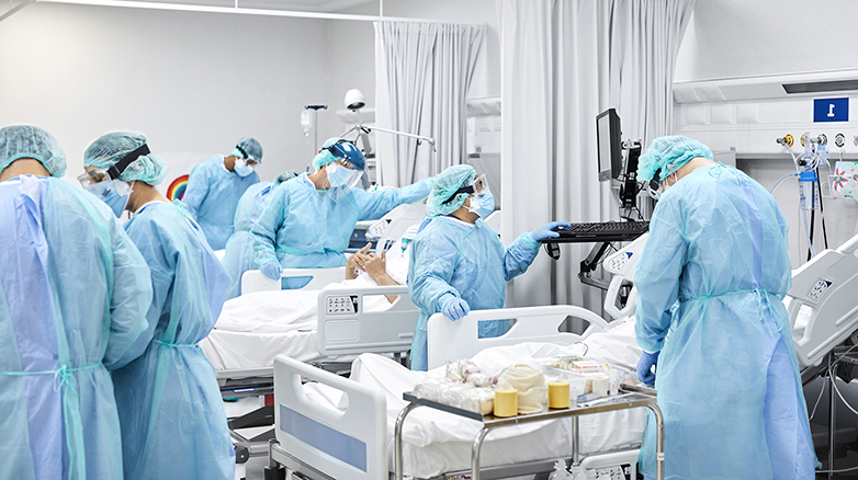 Medical professionals working in a hospital room