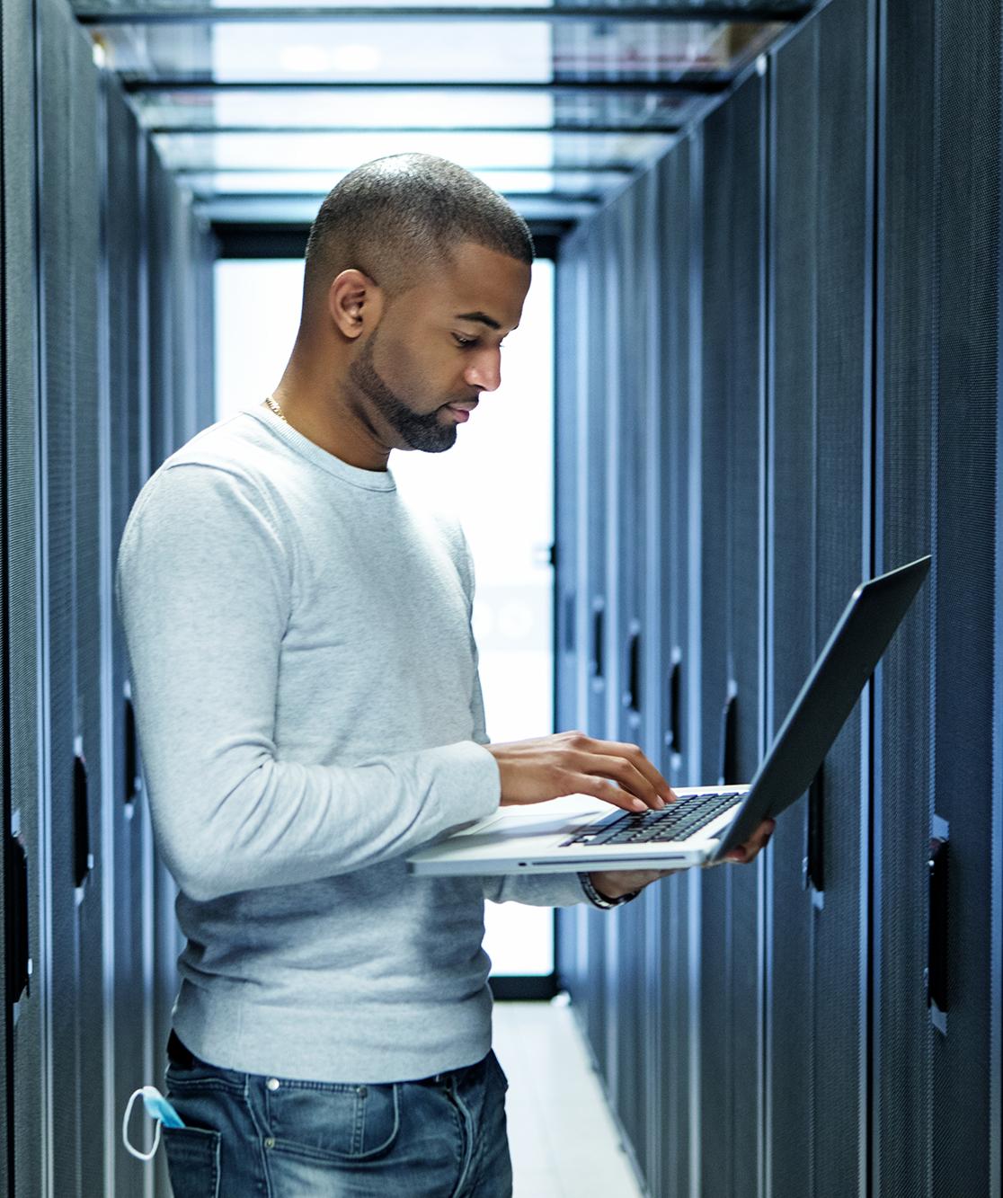 A black male server room technician working