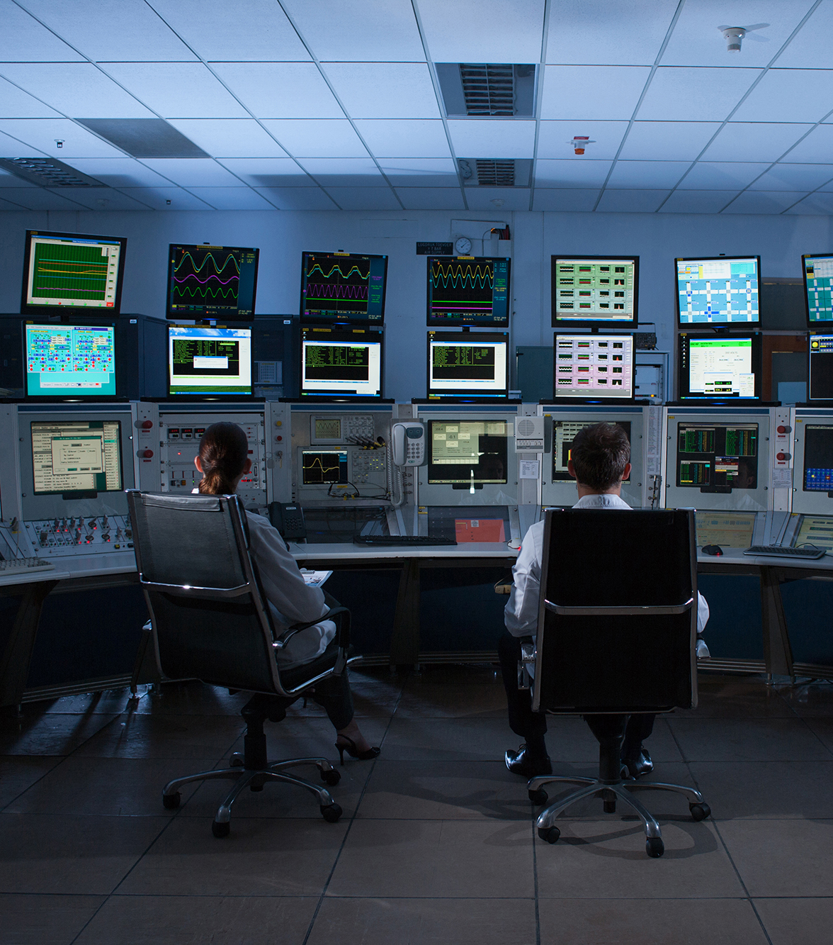 People monitoring computers in control room