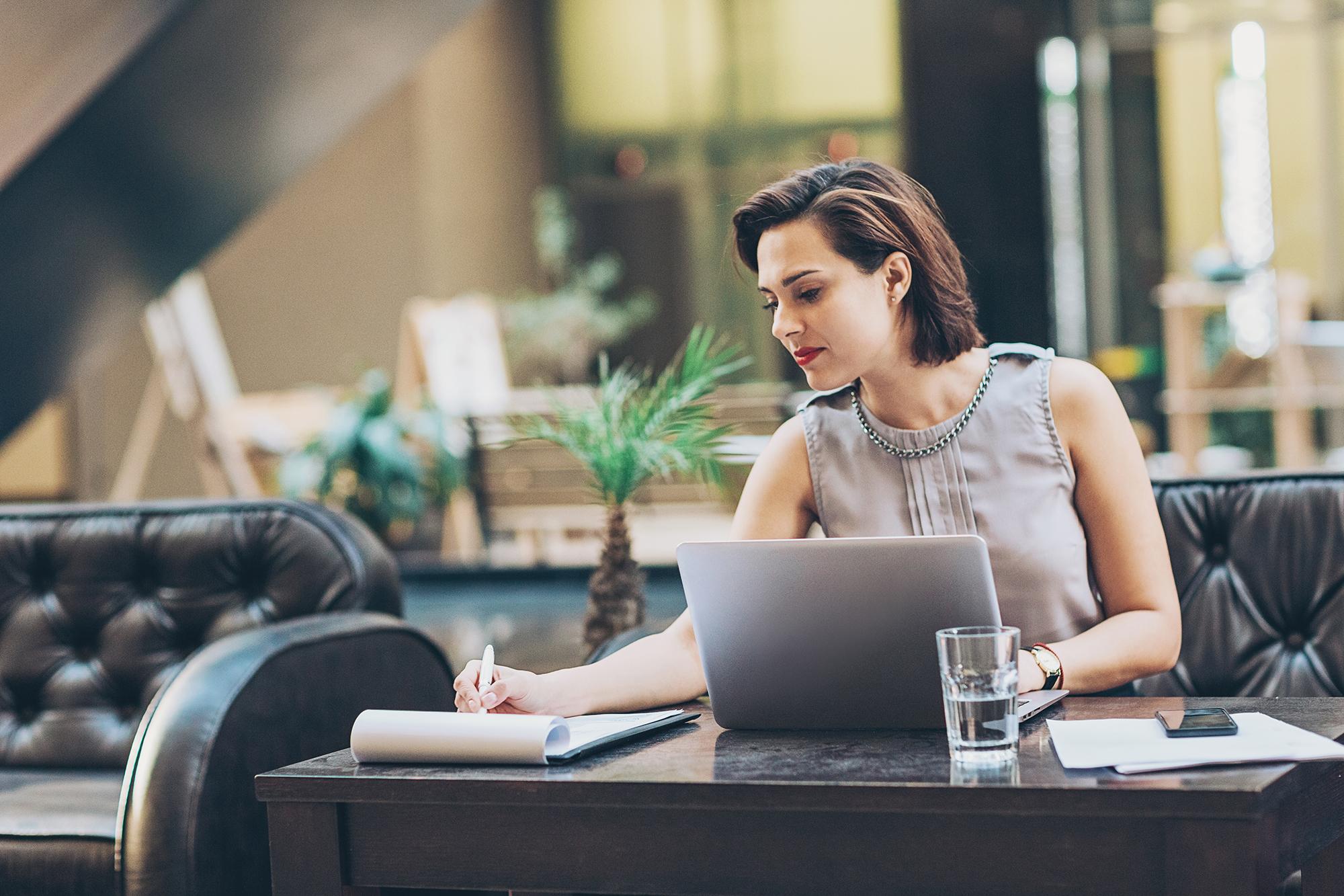 Businesswoman writing documents