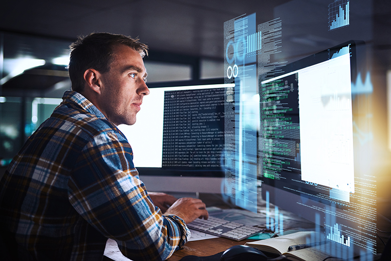 Programmer working on computer code