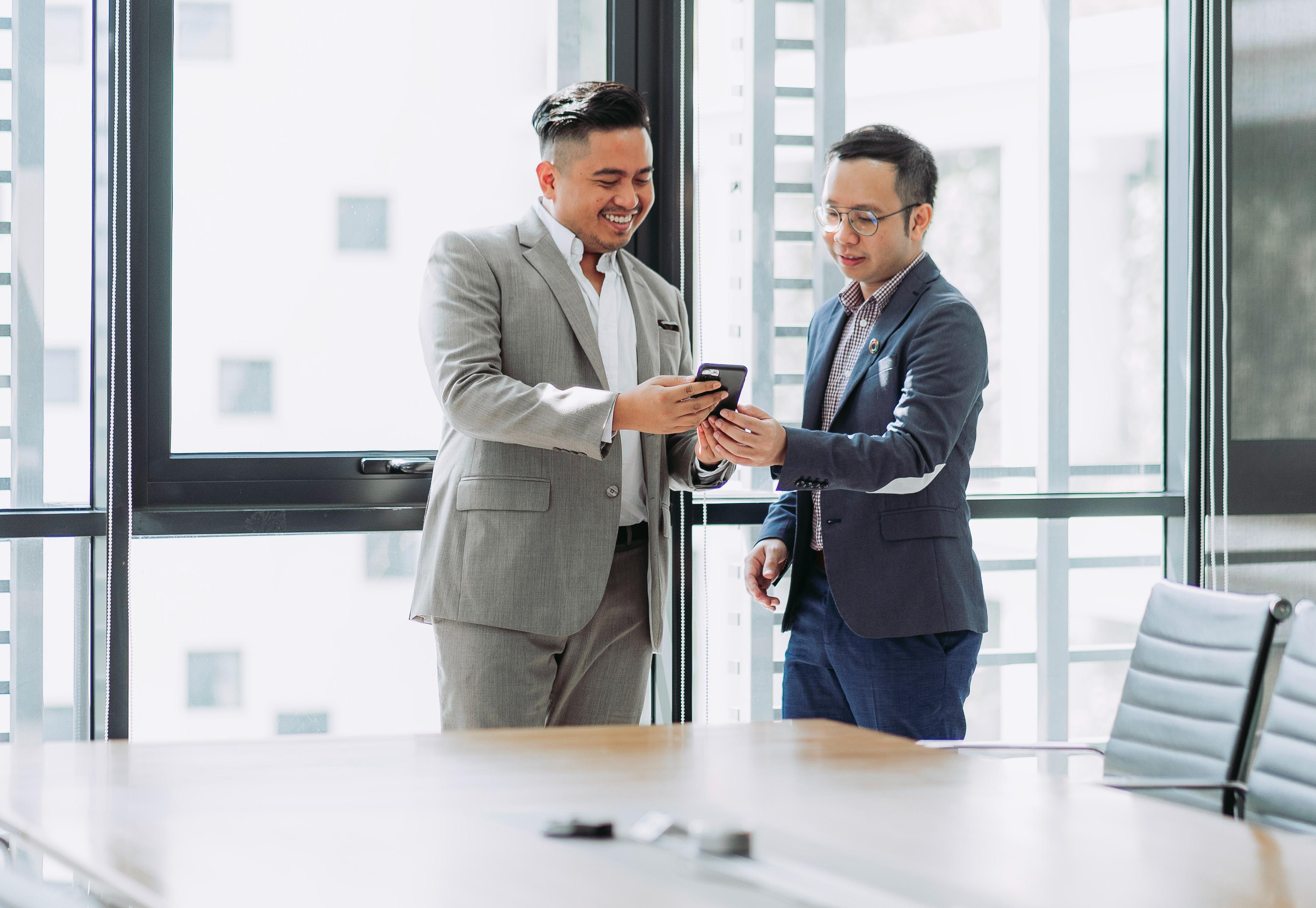 Two men talking in an office room